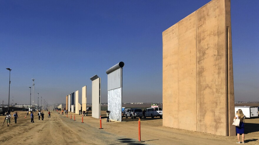 A photo from last October shows prototypes of border walls in San Diego that President Trump will be examining. He heads to California on Tuesday — his first visit to the state since becoming president.