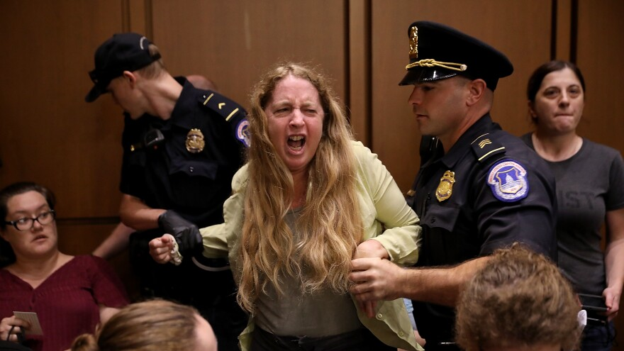 Protesters disrupt the confirmation hearing for Supreme Court nominee Kavanaugh. Capitol Police said 70 people were charged in connection with the protests.