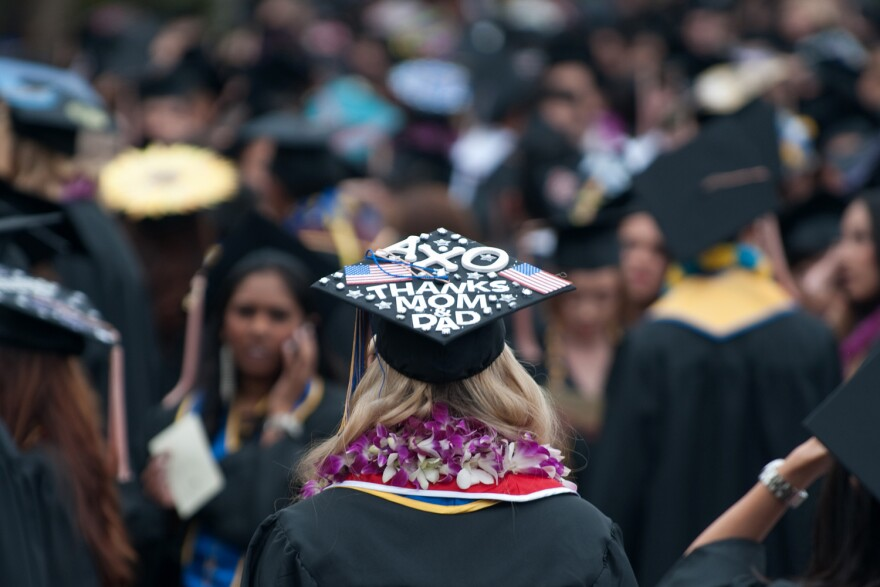 A graduate uses her mortarboard to express appreciation of her parents. (UCI UC Irvine/Creative Commons)