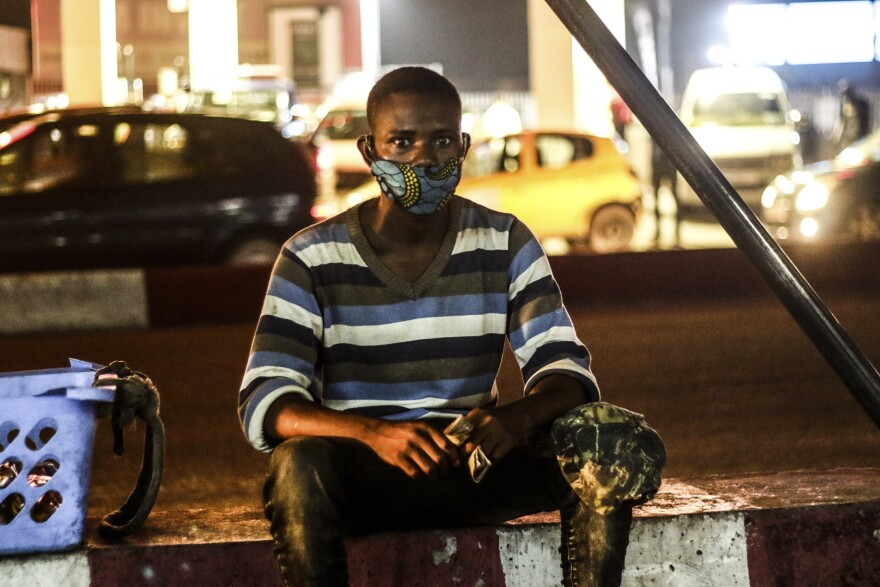Fabrice, a street vendor and a resident of the disadvantaged Camp Luka neighborhood of Kinshasa, says he cannot afford a disposable mask and so washes his cloth mask each night for use the next day.