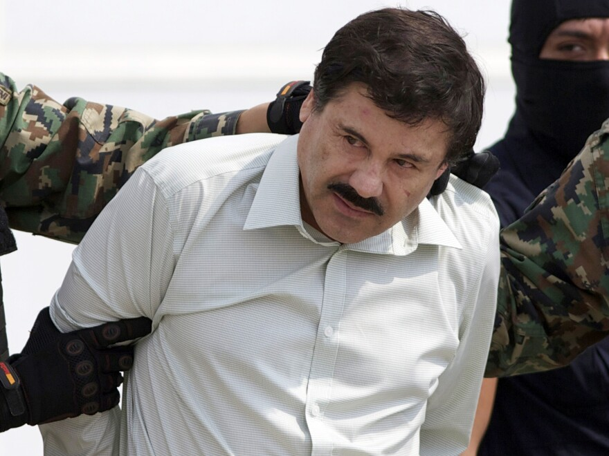 "A 2014 photo of Joaquín ""El Chapo"" Guzmán being escorted to a helicopter in Mexico City following his capture."