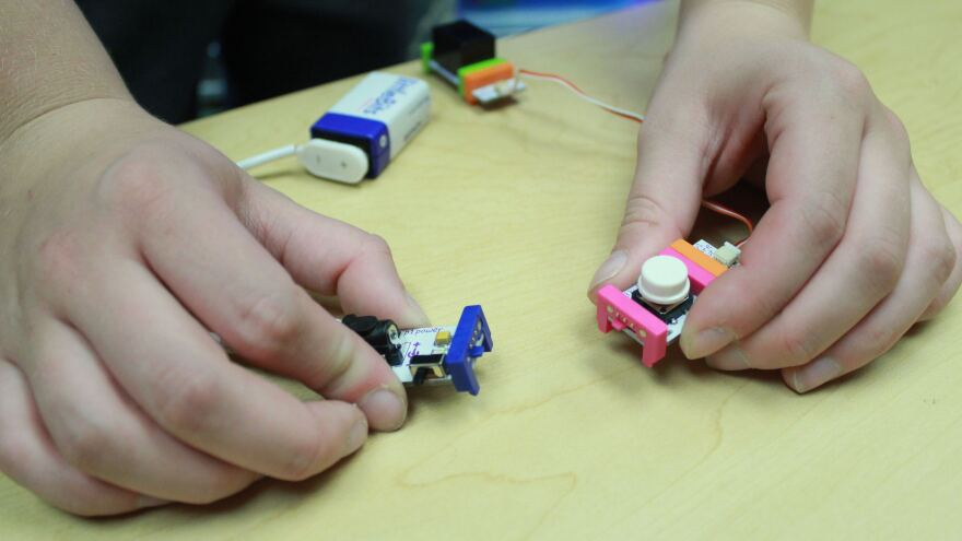 Emily Neblett, a patient at the Monroe Carell Jr. Children's Hospital in Nashville, Tenn., demonstrates circuit pieces from the mobile maker space that are connected by magnets.