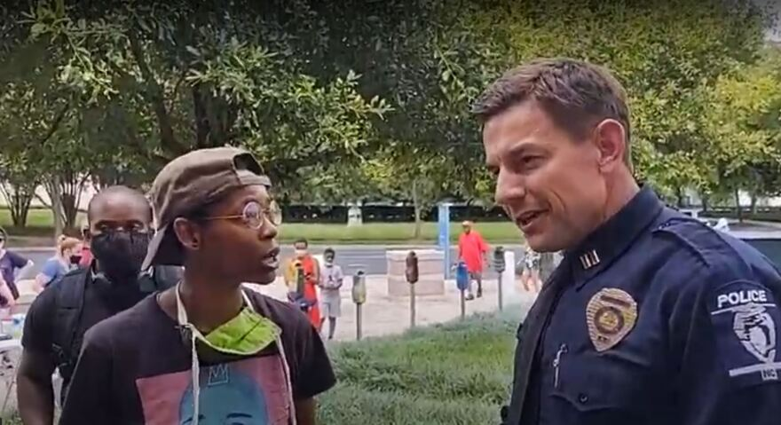 A Charlotte Uprising activist told Capt. Brad Koch he was not welcome at a rally Monday in Charlotte.