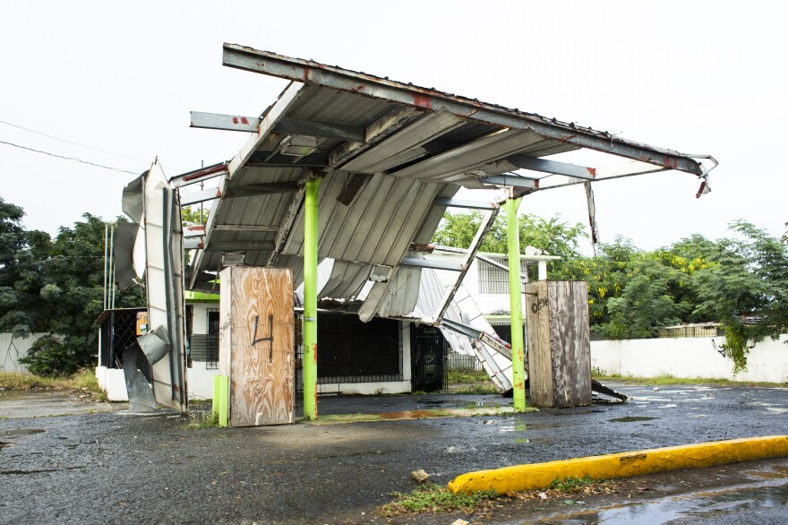 A gas station remains damaged in Loiza.