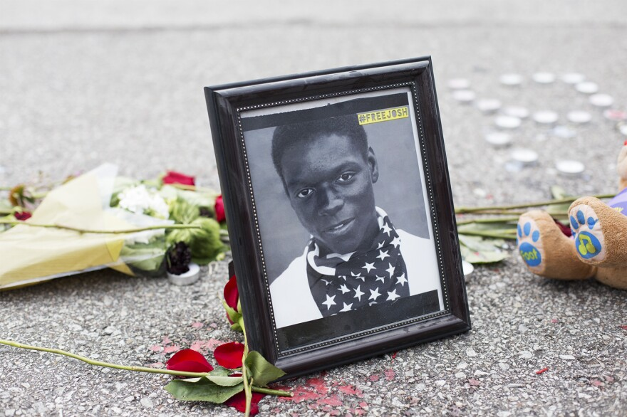 A framed photo of Joshua Williams rests on Canfield Drive on the fourth anniversary of Michael Brown's death.