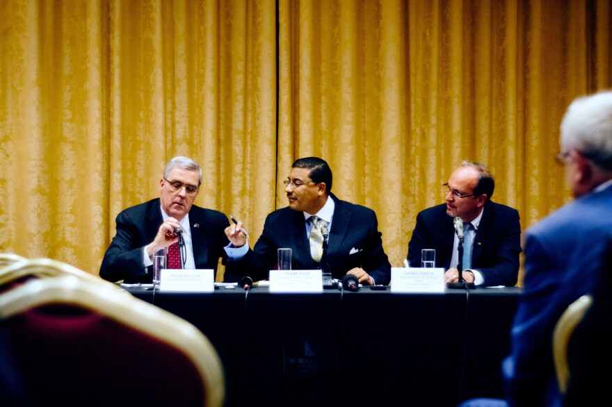 U.S. Ambassador to NATO Douglas Lute (left); Assistant Secretary of State for Arms Control, Verification and Compliance at the U.S. State Department Frank Rose (center); and the state secretary for strategic affairs in Romania's Foreign Ministry, Daniel Ionita, give a briefing on NATO's ballistic missile defense this month in Romania.