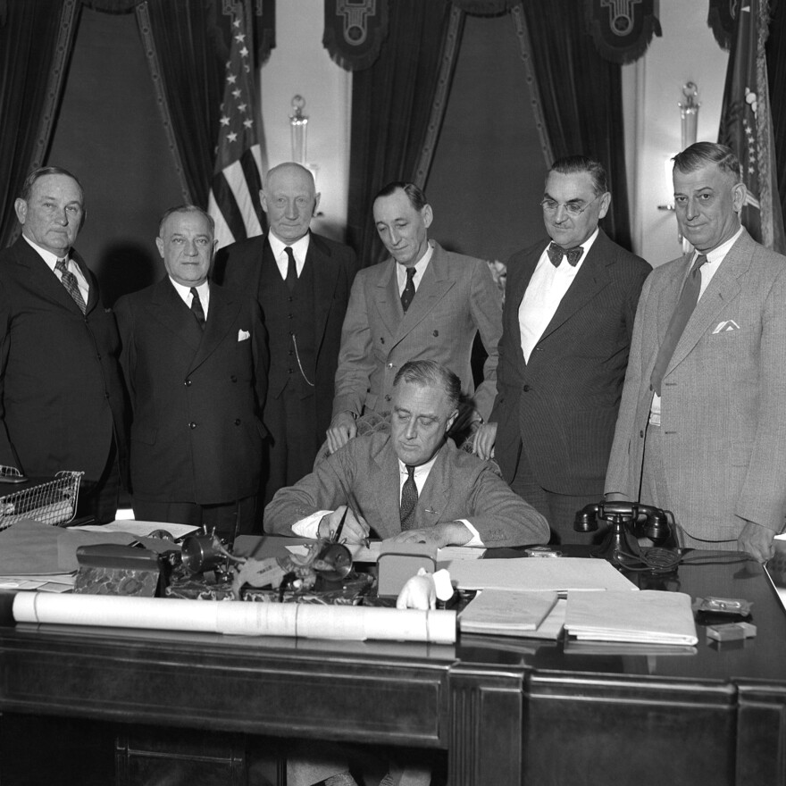 President Franklin D. Roosevelt, a Democrat, signs the National Industrial Recovery Act at the White House on June 16, 1933. After winning a fourth term, some state Republicans wanted distance from FDR on the ballot.