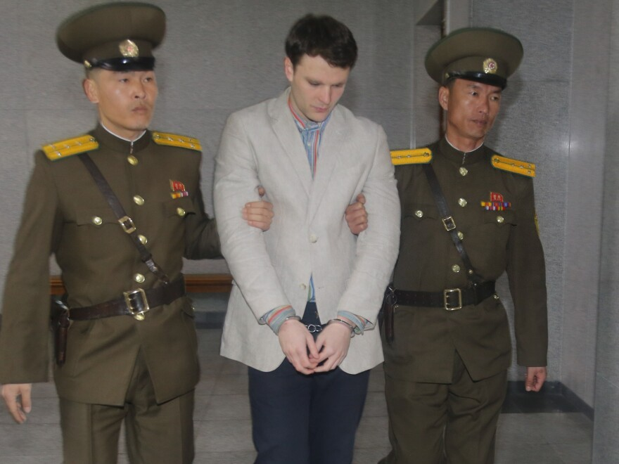 Warmbier is escorted to his March 2016 trial in Pyongyang, North Korea, at which he was sentenced to 15 years in prison and hard labor.