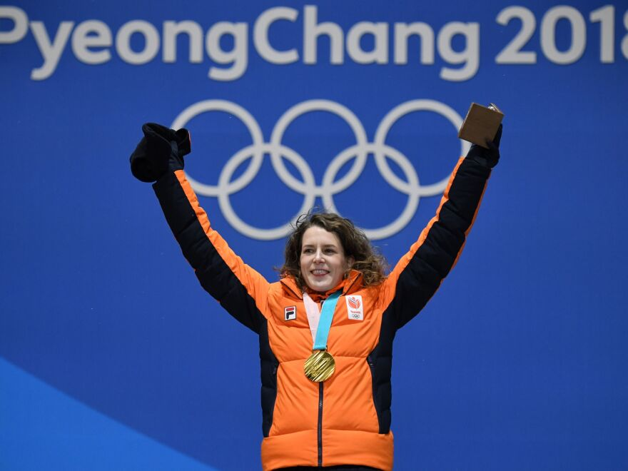 PYEONCHANG - Ireen Wust poses on the podium during the medal ceremony for the speed skating women's 1500m at the 2018 Winter Olympic Games in Pyeongchang on February 13, 2018. f(Krill Kudryavstev/AFP/Getty Images)