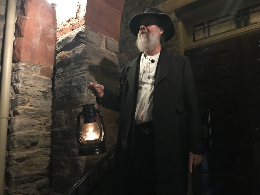 Rick Garland took over the Ghost Tours of Harpers Ferry 10 years ago. He holds the tour year-round and meets tourists on the steps of the historic St. Peter's Roman Catholic Church.