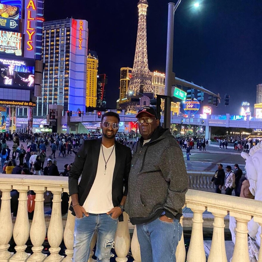 Girish Venkatesh (shown here in Las Vegas with his then-host father, William Johnson) has come to the U.S. from India twice to study. The second time, he was struck with unexpected losses: Johnson died and he had to find a new host family, and the pandemic meant he shifted to online learning.