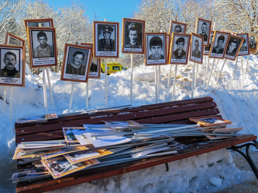 Photos of soldiers who served in Afghanistan are stacked up in a Moscow park after a ceremony marking the 30th anniversary of the Soviet Army's withdrawal. The memory of the disastrous and unpopular war has guided recent Russian military interventions.