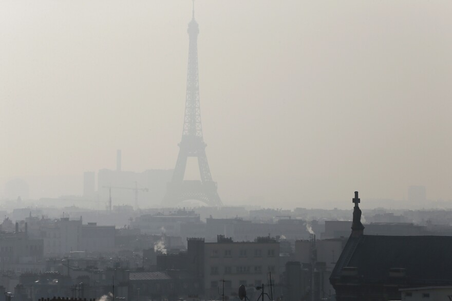 A photo taken on Feb. 12 shows the Eiffel Tower in Paris through thick smog.