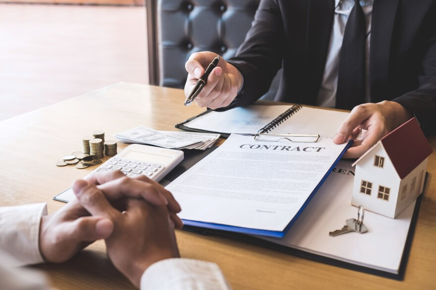 Estate agent broker giving pen to client signing agreement contract real estate with approved mortgage application form, buying or concerning mortgage loan offer for and house insurance