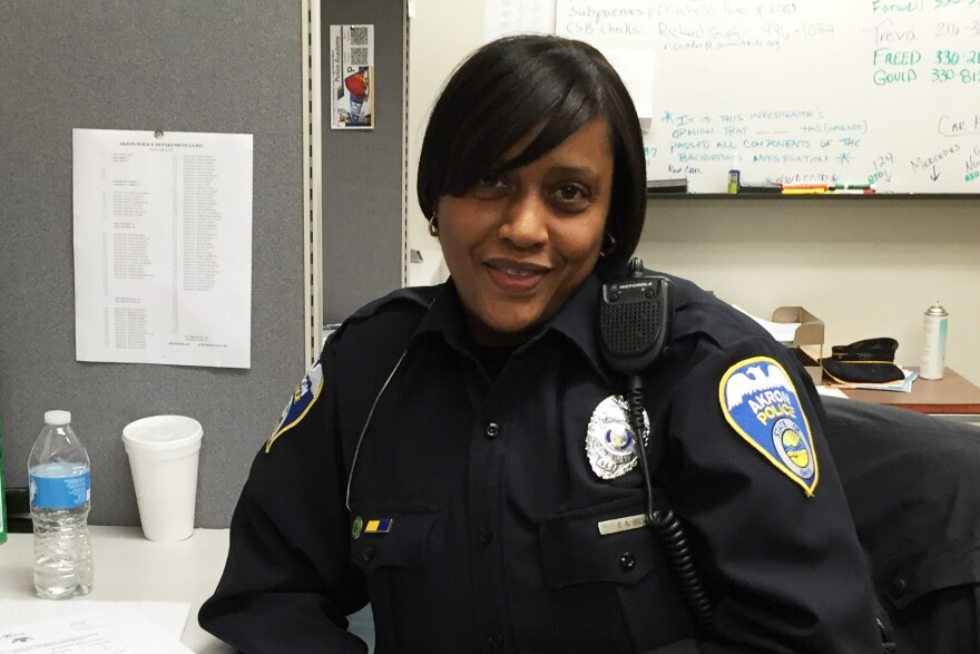 Carol Hill says her work as a social worker was good training for joining the Akron police force. She's part of the force's recruiting team that's boosting its diversity efforts.