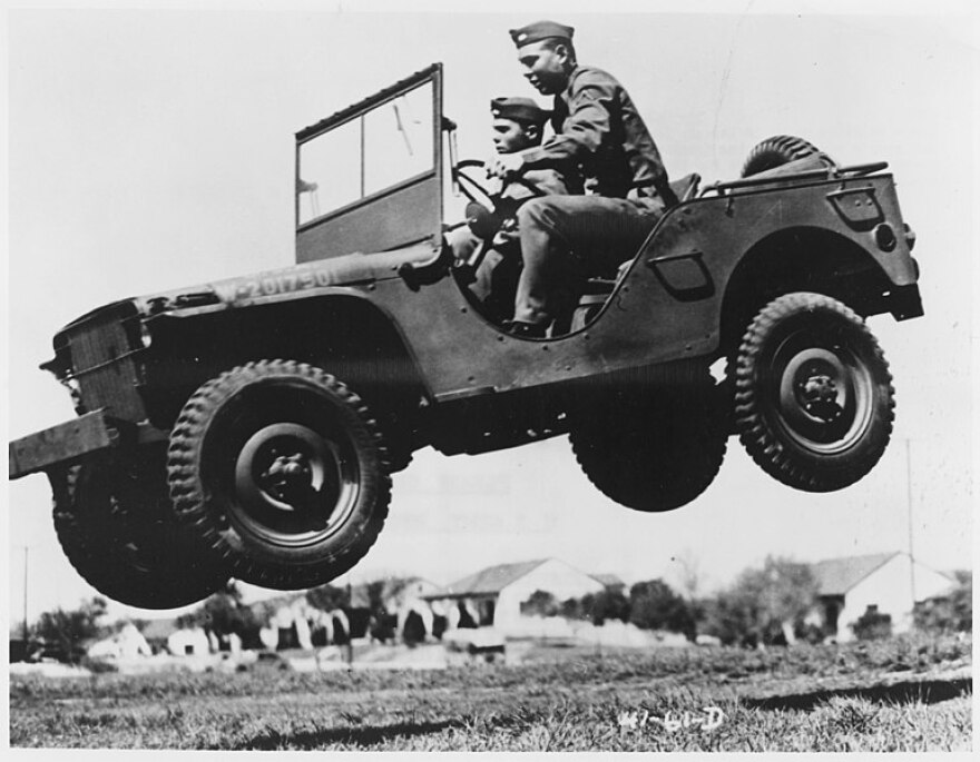 771px-These_soldiers_go_up_in_the_air_to_prove_that_the_Army's_new_quarter_ton_truck_can_take_it._-_NARA_-_195336.jpg