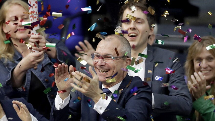 Green Party's gay rights activist Volker Beck, center, and fellow faction members celebrate with a confetti popper after Germany's Parliament voted on Friday to legalize same-sex marriage.