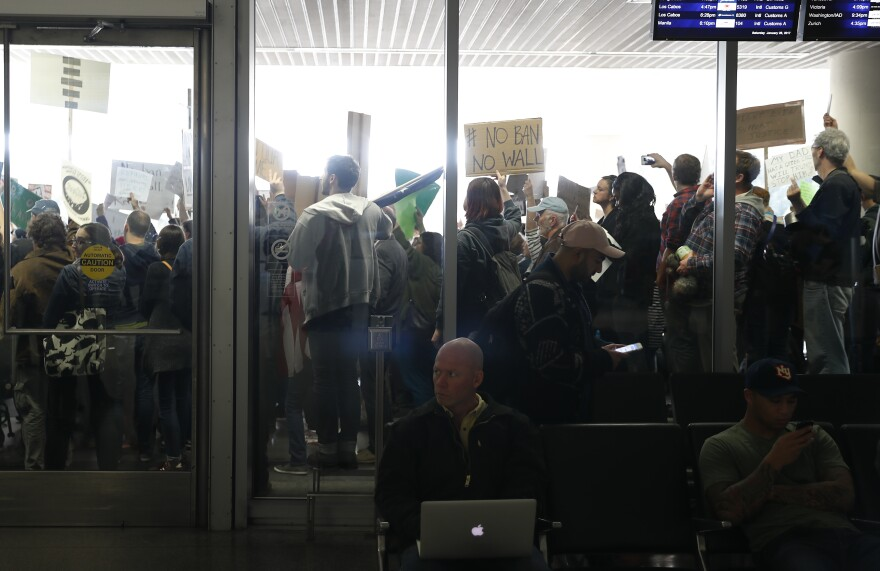 People at the international arrival terminal at San Francisco International Airport protest President Trump's executive order on immigration on Saturday.