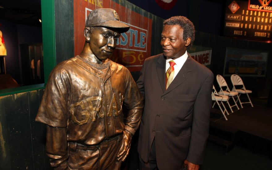 Lou Brock stands with the bronze statue of Negro Leaguer Oscar Charleston while at the Negro Leagues Baseball Museum in Kansas City on July 9, 2012. Brock was on hand to accept the Jackie Robinson Lifetime Achievement Award.