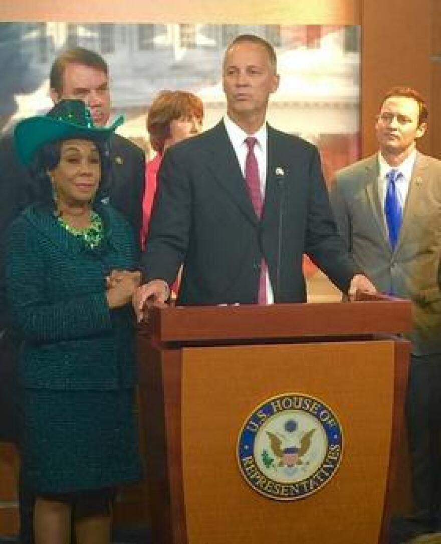 Rep. Curt Clawson (R-FL)(middle) along with Rep. Frederica Wilson (D-FL)(left) joined by a bipartisan group of Florida's Congressional Delegation for a press conference, calling for passage of a clean Zika funding bill.