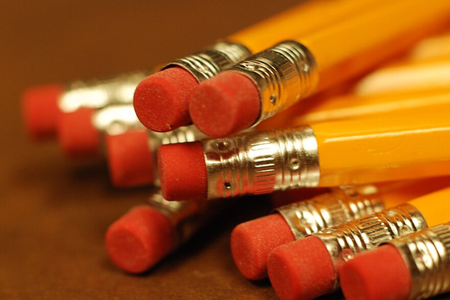 pencils clustered together on a table