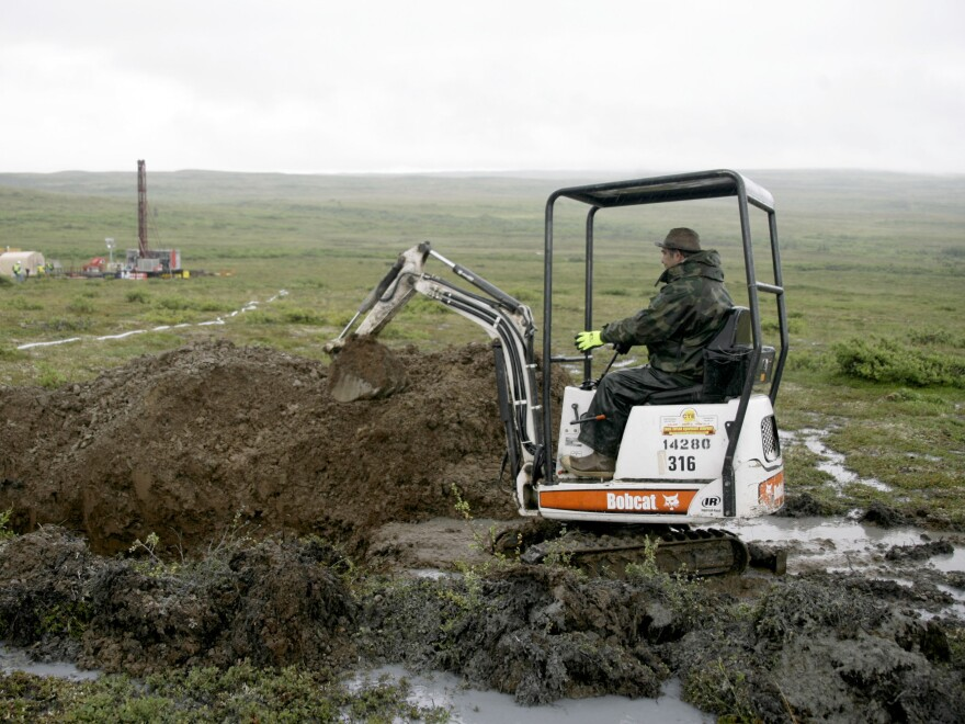 In this file photo, a worker with the Pebble Mine project test drills in the Bristol Bay region of Alaska.