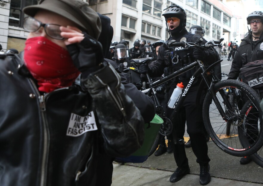 Seattle police officers use mountain bikes as crowd control devices while attempting to disperse anti-fascist protesters during the United Against Hate rally in Seattle last month.