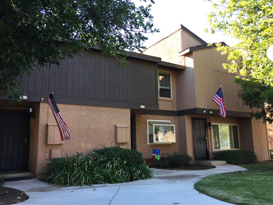 There are now American flags on either side of the home where Syed Farook and Tashfeen Malik lived in San Bernardino, Calif.