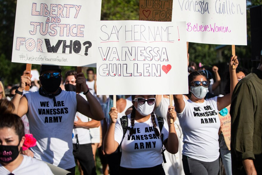 Protesters hold signs in support of Vanessa Guillen, a Fort Hold soldier who went missing in April and was later found dead.