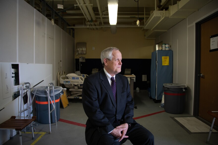 Craig DeAtley directs Emergency Management at MedStar. One goal in creating more room to handle an expected surge of COVID-19 patients, he says, is to move the assessment of some walk-in ER patients to stations in this room — as well as to stations in large tents being set up in parking lot.