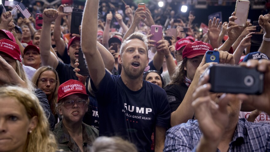 President Trump's supporters cheer as he speaks at a rally in Nashville, Tenn., in May. While Democrats are fired up for these midterms, so are his voters.