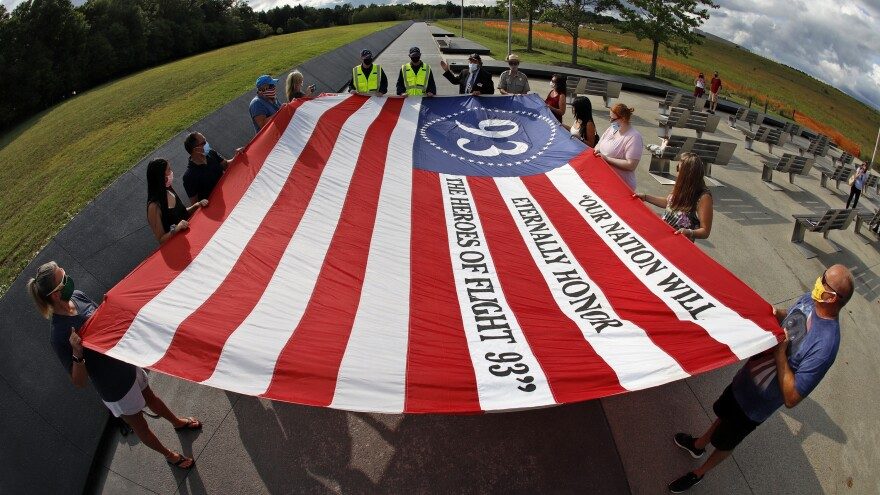 Visitors to the Flight 93 National Memorial in Shanksville, Pa., participate in a memorial service Thursday ahead of the 19th anniversary of the Sept. 11 attacks.