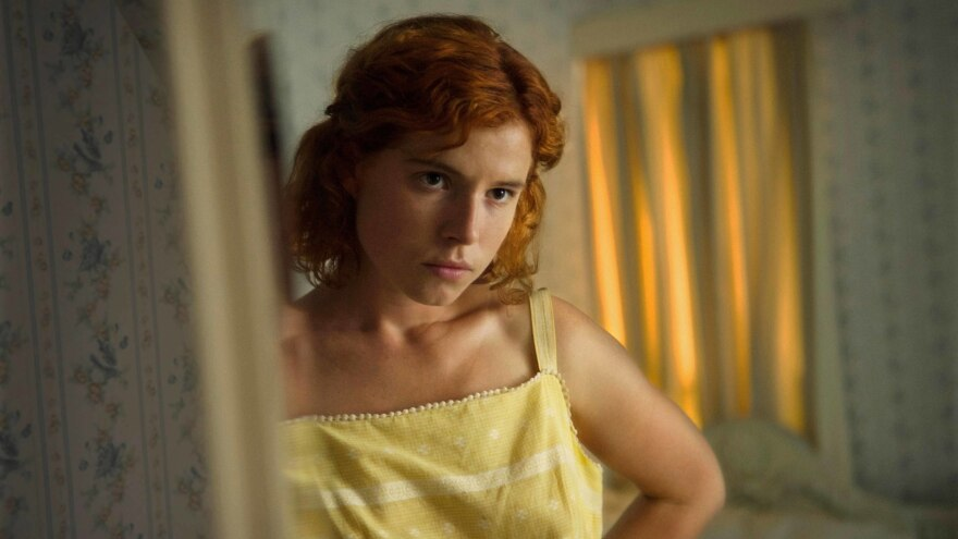 Moll (Jessie Buckley) gets ready to go out in the thriller <em>Beast</em>.