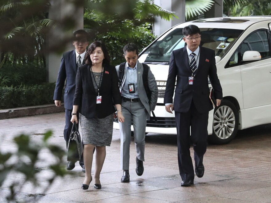 North Korean Vice Foreign Minister Choe Son Hui (second from left) arrives for a meeting with U.S. Ambassador to the Philippines Sung Kim at the Ritz-Carlton Millennia Hotel in Singapore on Monday.