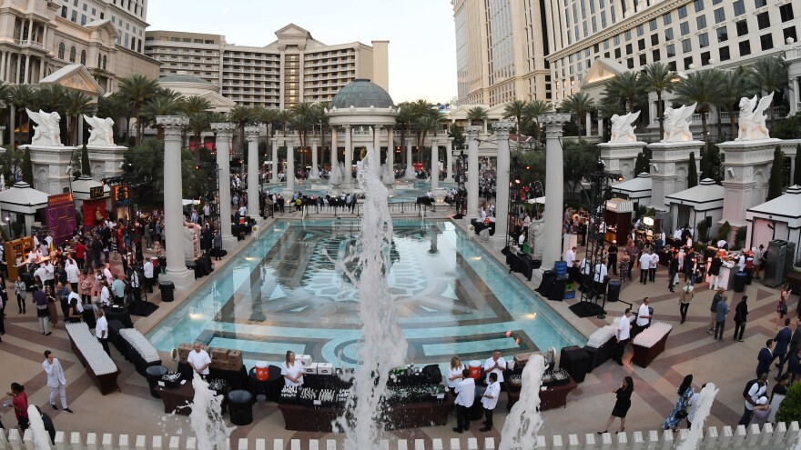 Caesars Palace and other famous casinos will now be owned by Eldorado Resorts, in a deal the two companies announced on Monday. Here, Caesars Palace is seen hosting a food tasting event in Las Vegas last month.