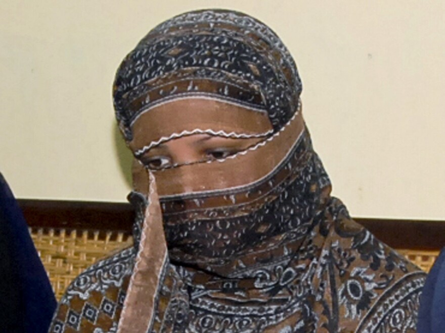 Asia Bibi, a Pakistani Christian woman, listens to officials in 2010 at a prison near Lahore. Her blasphemy conviction has been reversed but advocates say she and her family are in danger in Pakistan.