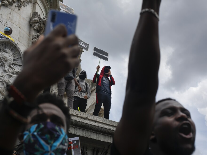 People gather at the Place de la Republique in Paris on Saturday for a march against police brutality and racism.