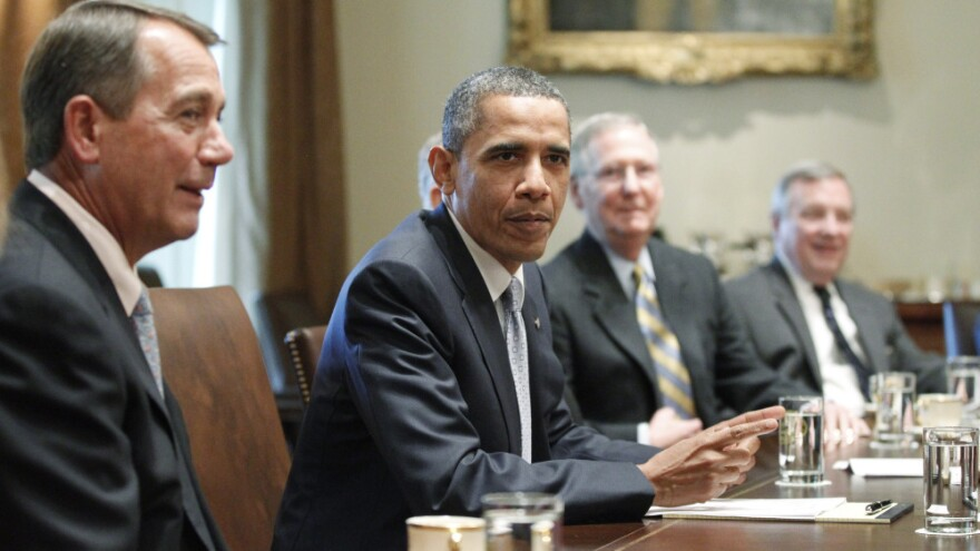 President Obama sits with (from left) House Speaker John Boehner (R-OH), Senate Minority Leader Mitch McConnell (R-KY) and Sen. Dick Durbin (D-IL) during a meeting Wednesday at the White House on raising the debt ceiling. While the president negotiates with congressional leaders to avoid a possible debt default next month, some lawmakers say they won't vote to raise the debt ceiling.