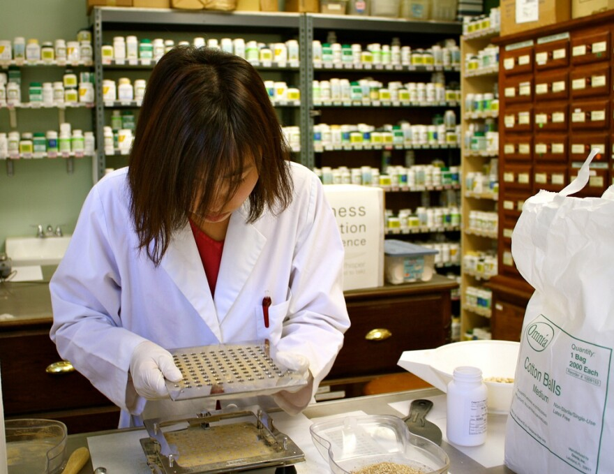 Traditionally drug compounding is done by a pharmacist in small batches, but compounding pharmacies process drugs on a larger scale.