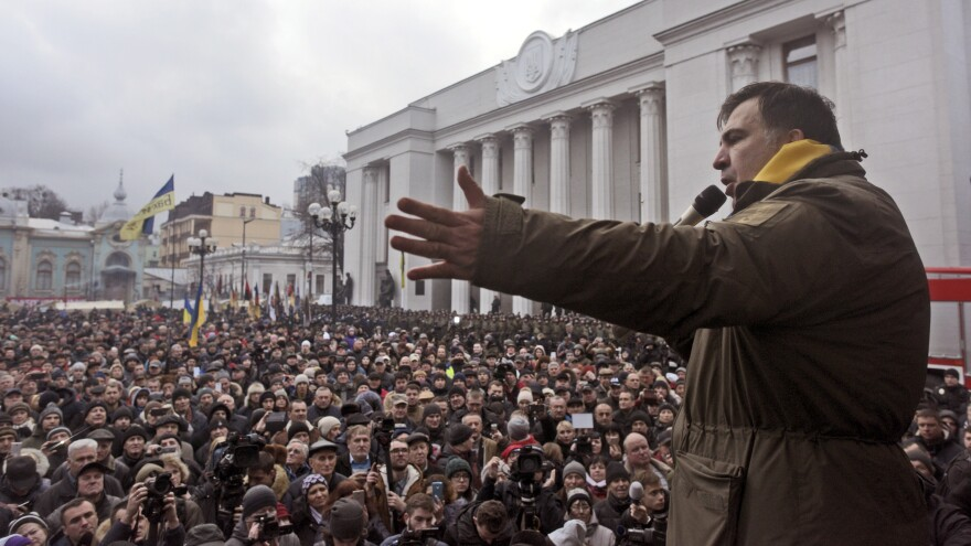 Saakashvili addresses his supporters after escaping from law enforcement and leading them on a march toward the Parliament building in Kiev on Tuesday.