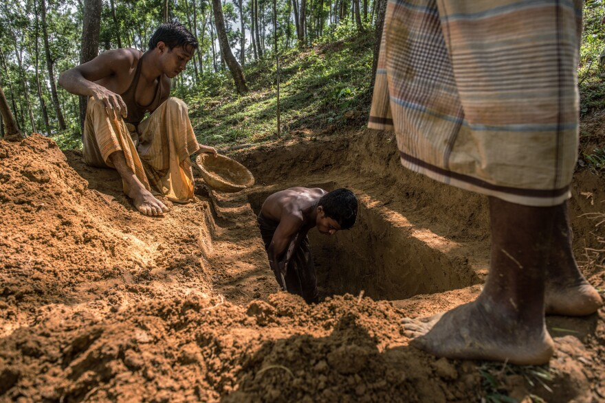A team of gravediggers prepares a grave on the hillside near the Kutupalong refugee camp.