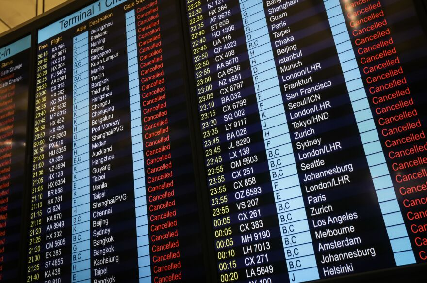 An information board shows canceled flights at Hong Kong's international airport.