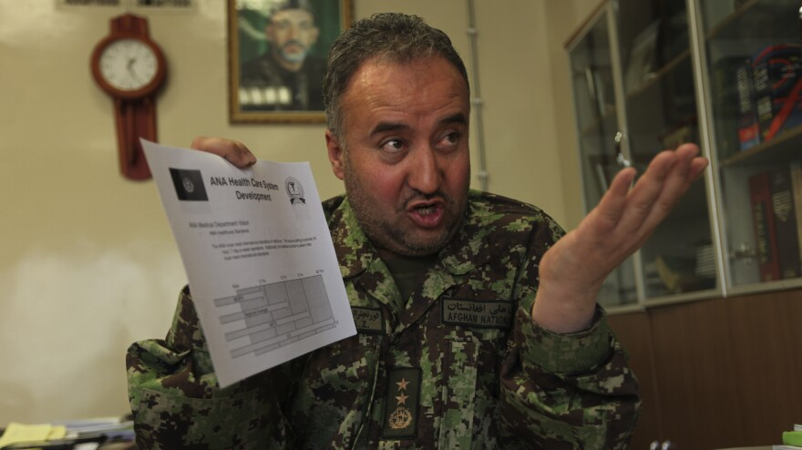 U.S. investigators allege that Afghan Gen. Ahmad Zia Yaftali stole tens of millions of dollars' worth of medicine from the Mohammad Daud Khan military hospital in Kabul. He has been removed from that post, but has not been prosecuted. He's shown here at the hospital on Dec. 18, 2010.
