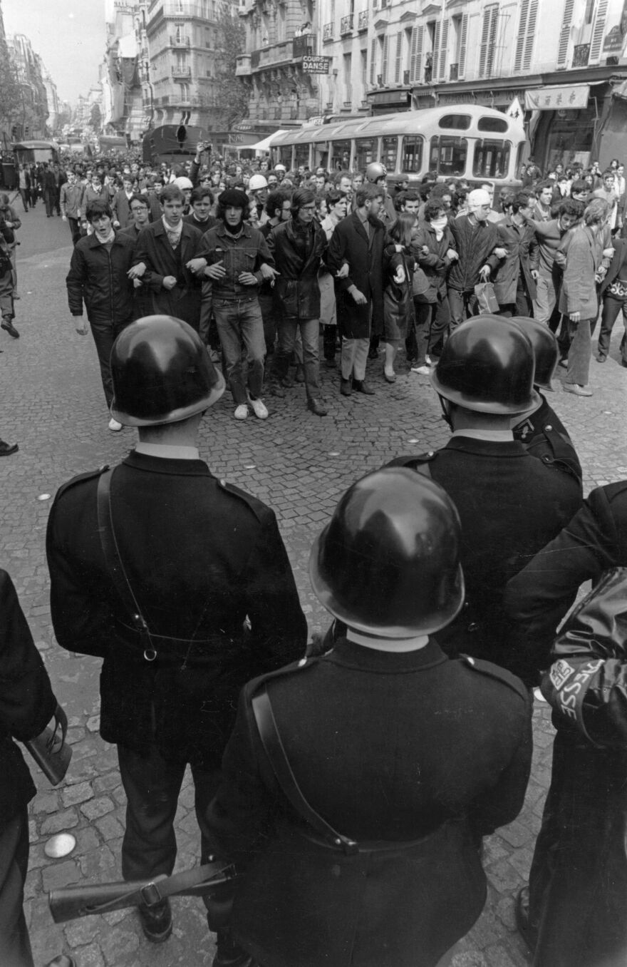 Students and police facing each other in a Paris street during the student riots.