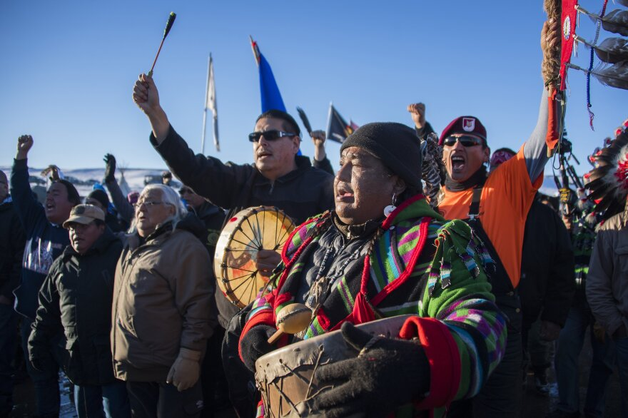 Protesters celebrate at Oceti Sakowin Camp earlier Sunday. The Army Corps of Engineers notified the Standing Rock Sioux that the current route for the Dakota Access Pipeline will be denied.