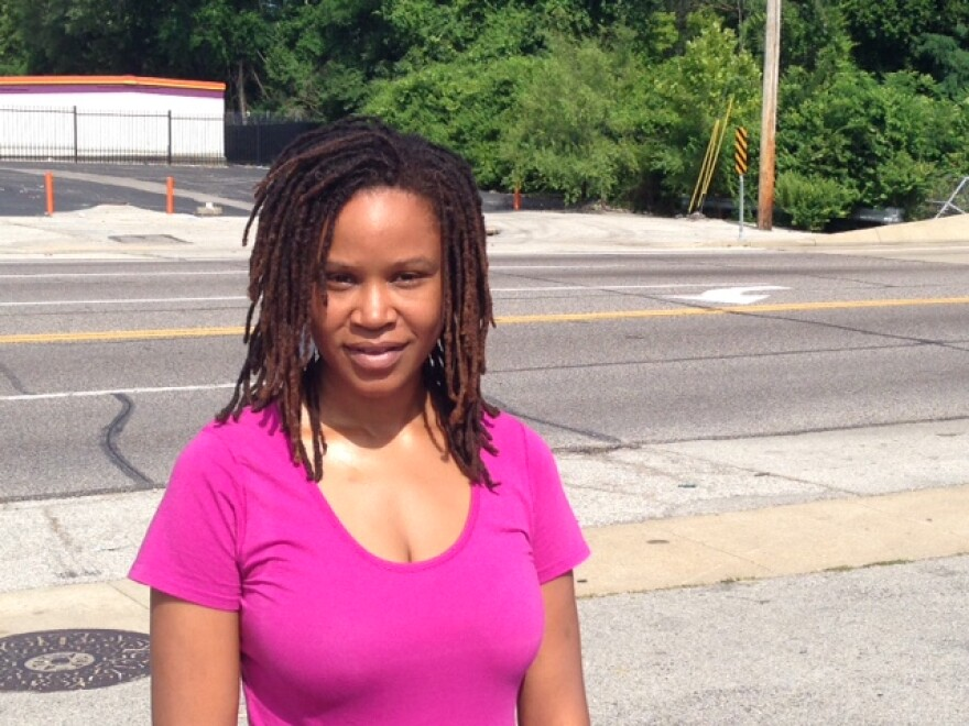 Kristine Hendrix stands in the parking lot that once housed Red's BBQ.