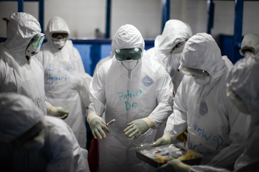 Among the dilemmas that arise when health workers are in their protective garb: What if you can't find the person assigned to be your Ebola Treatment Unit partner?