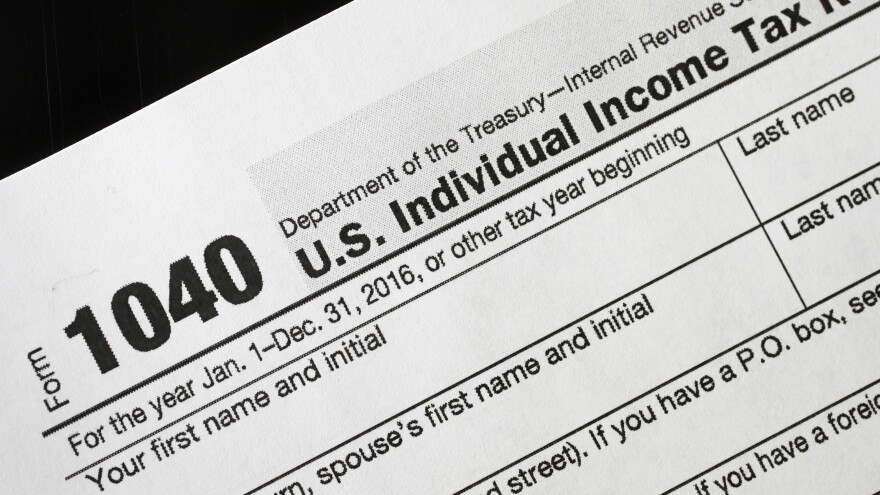 Photo of a blank federal income tax return. The White House confirmed an MSNBC report Tuesday that President Trump paid $38 million in federal taxes in 2005.