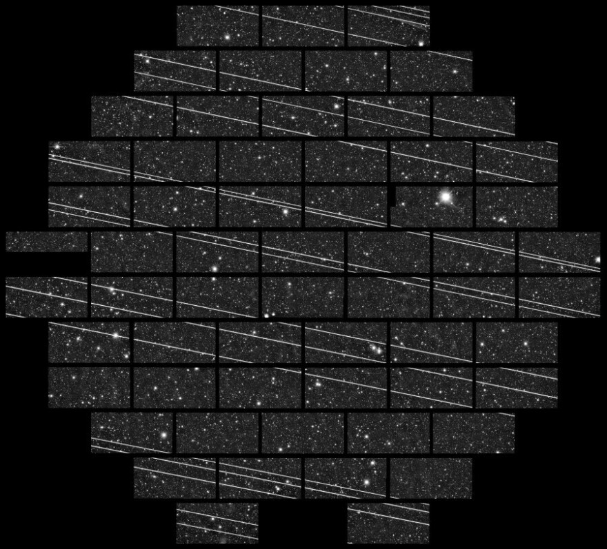 An image from the Cerro Tololo Inter-American Observatory showing at least 19 streaks that astronomers quickly surmised were Starlink satellites.