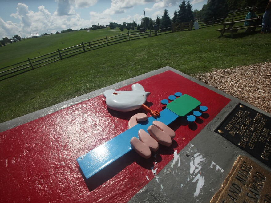 A plaque marks the site of the original Woodstock festival in Bethel, N.Y.